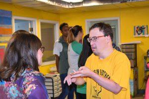 Student speaking with Bazaarvoice volunteer